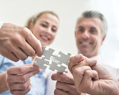 Business people putting pieces of a puzzle together