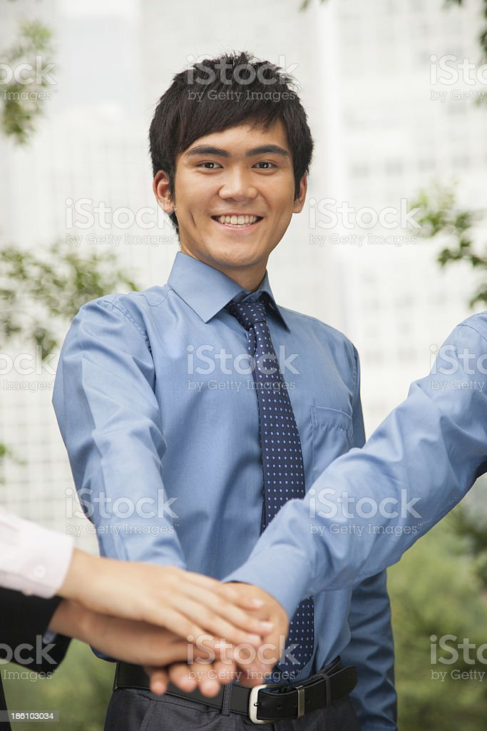 Business people putting their hand together royalty-free stock photo