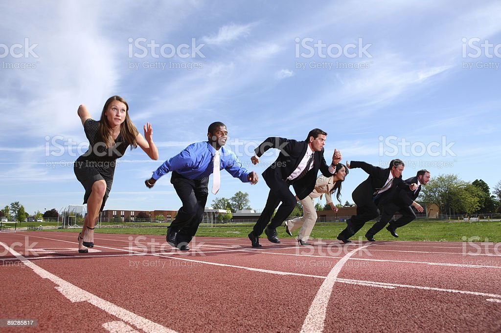 Business people racing on track stock photo