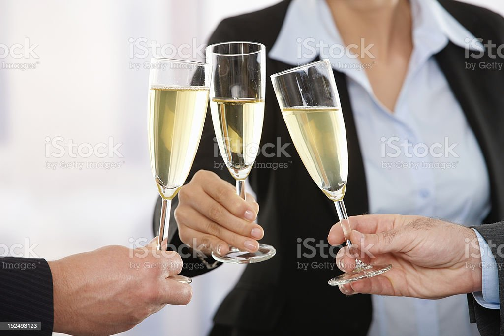 Business people raising toast with champagne royalty-free stock photo