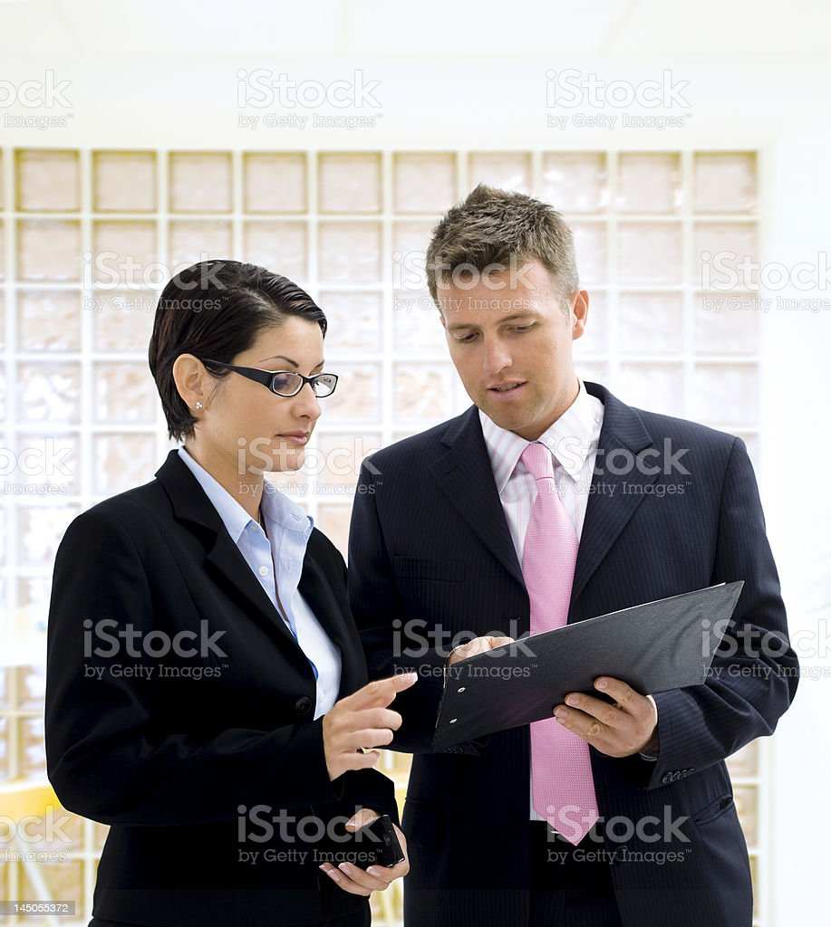 Business people reading document royalty-free stock photo