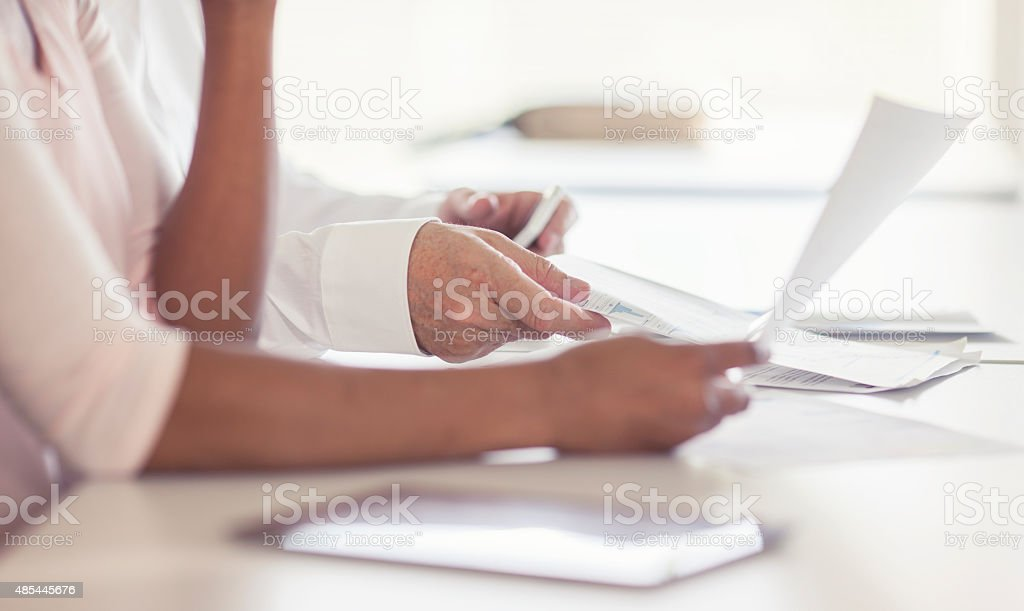 Business people reading documents stock photo