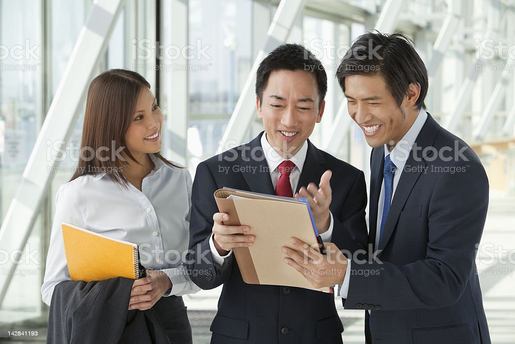 Business people reading paperwork royalty-free stock photo