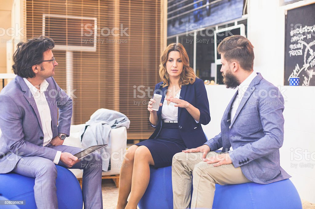 Business people relaxing in the lobby stock photo