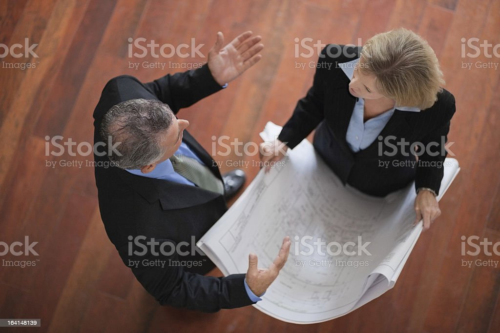 Business People Review Building Plans royalty-free stock photo