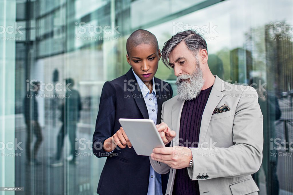 Business people reviewing some work outdoors the office stock photo