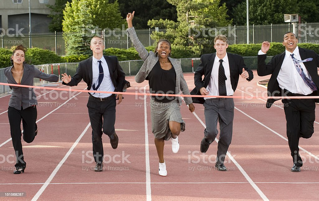 Business People Running Across the Finish Line royalty-free stock photo