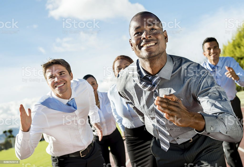 Business people running stock photo