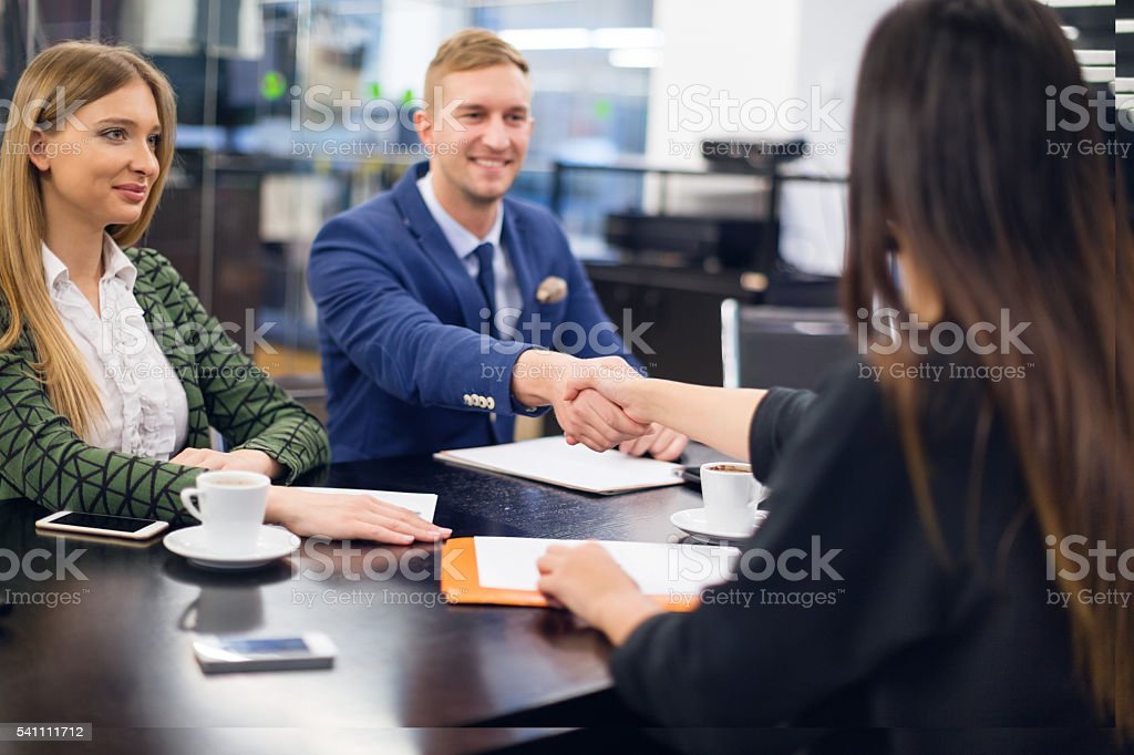 Business people shaking hands at meeting stock photo