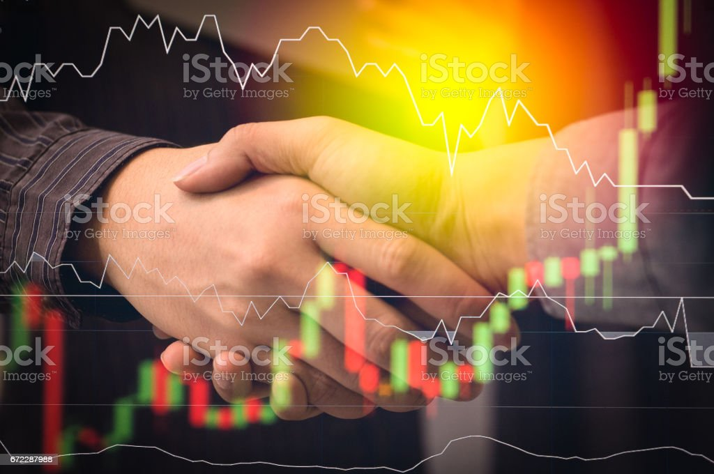 Business people shaking hands, finishing up a meeting, Partnership Teamwork Deal Cooperation stock photo