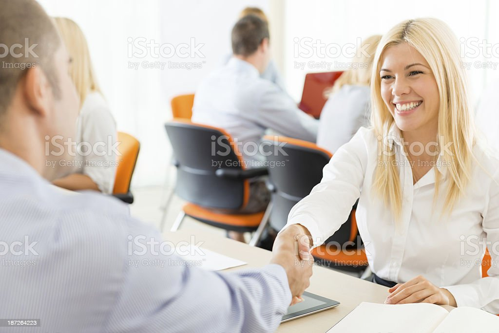 Business people shaking hands, finishing up a meeting royalty-free stock photo