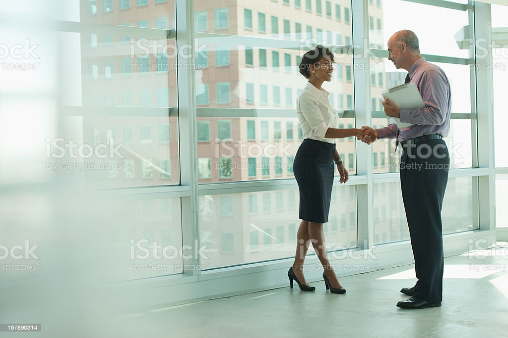Business people shaking hands in office stock photo