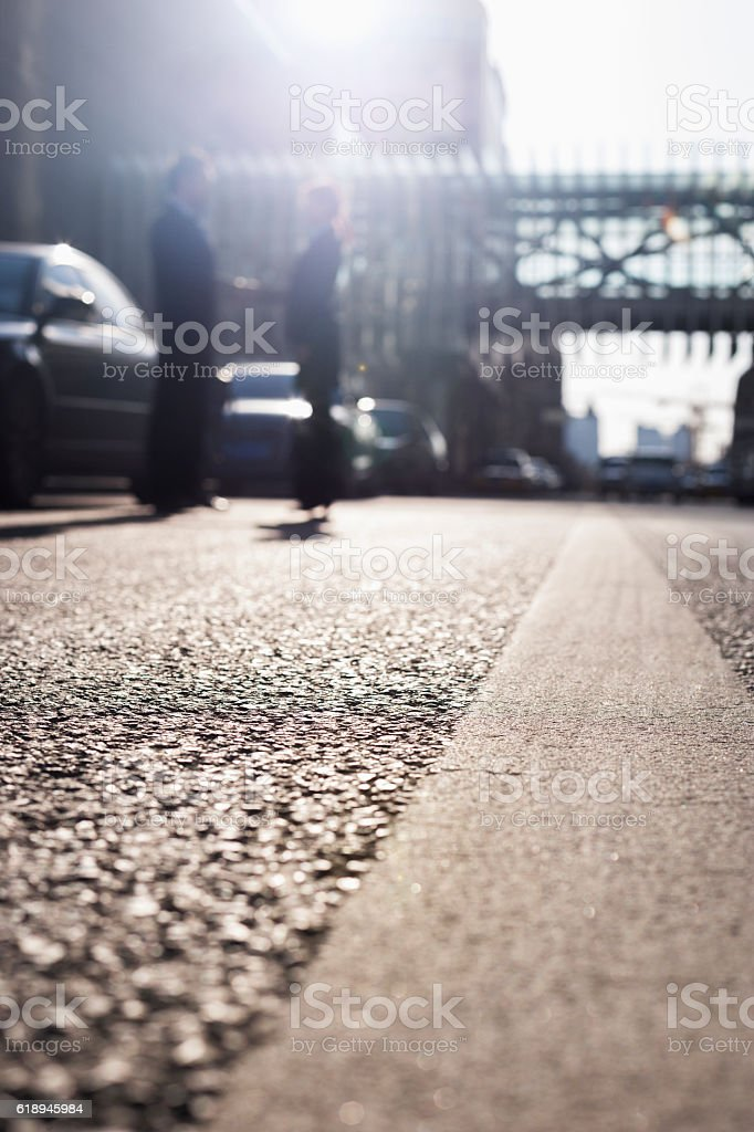 Business people shaking hands in street in city stock photo