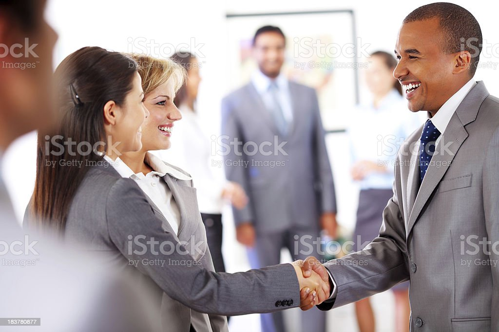 Business people shaking hands in the office. royalty-free stock photo