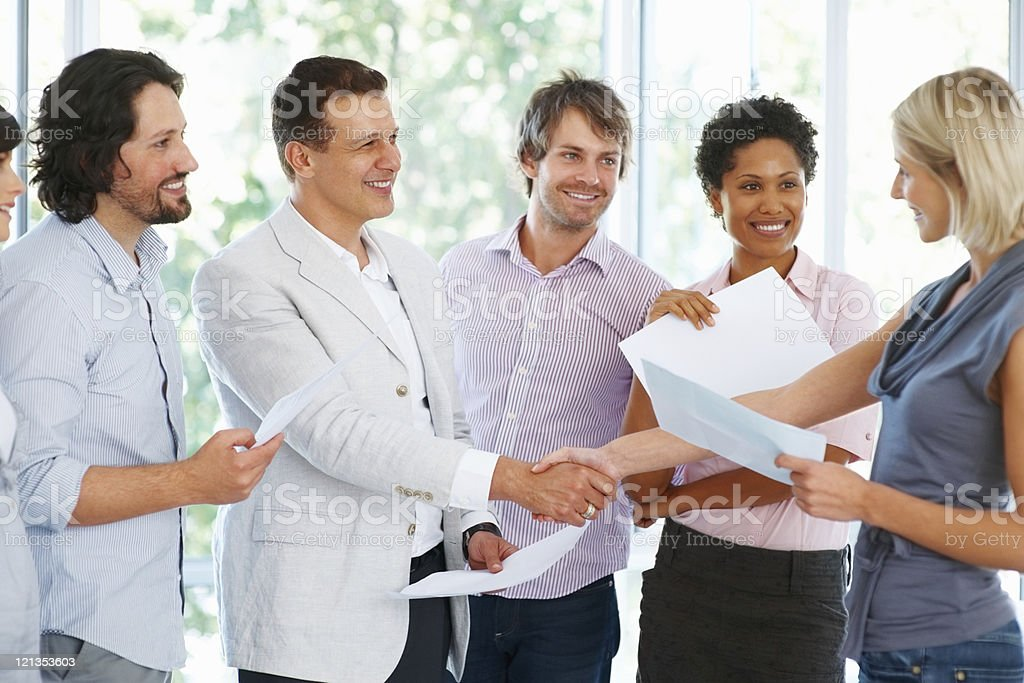 Business people shaking hands on a deal royalty-free stock photo