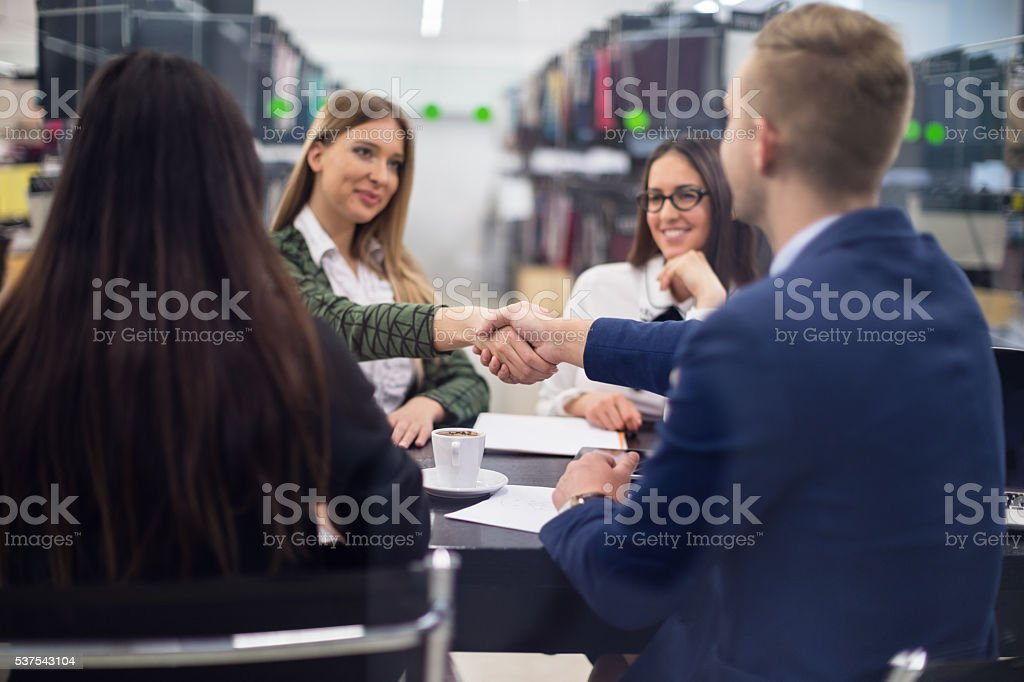 Business people shaking hands on a meeting stock photo