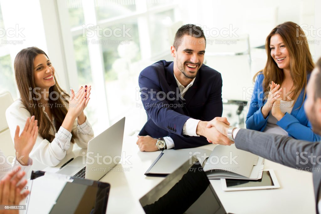 Business people shaking hands when finishing up a meeting stock photo