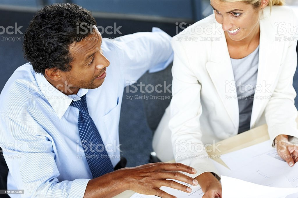 Business people sharing ideas at meeting royalty-free stock photo