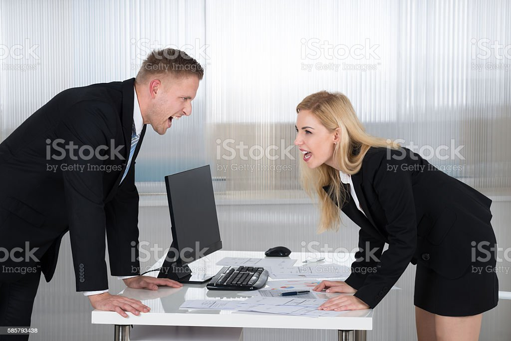 Business People Shouting At Each Other In Office stock photo