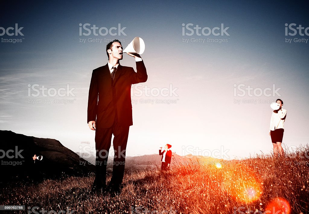 Business People Shouting Through Paper Megaphone Concept stock photo
