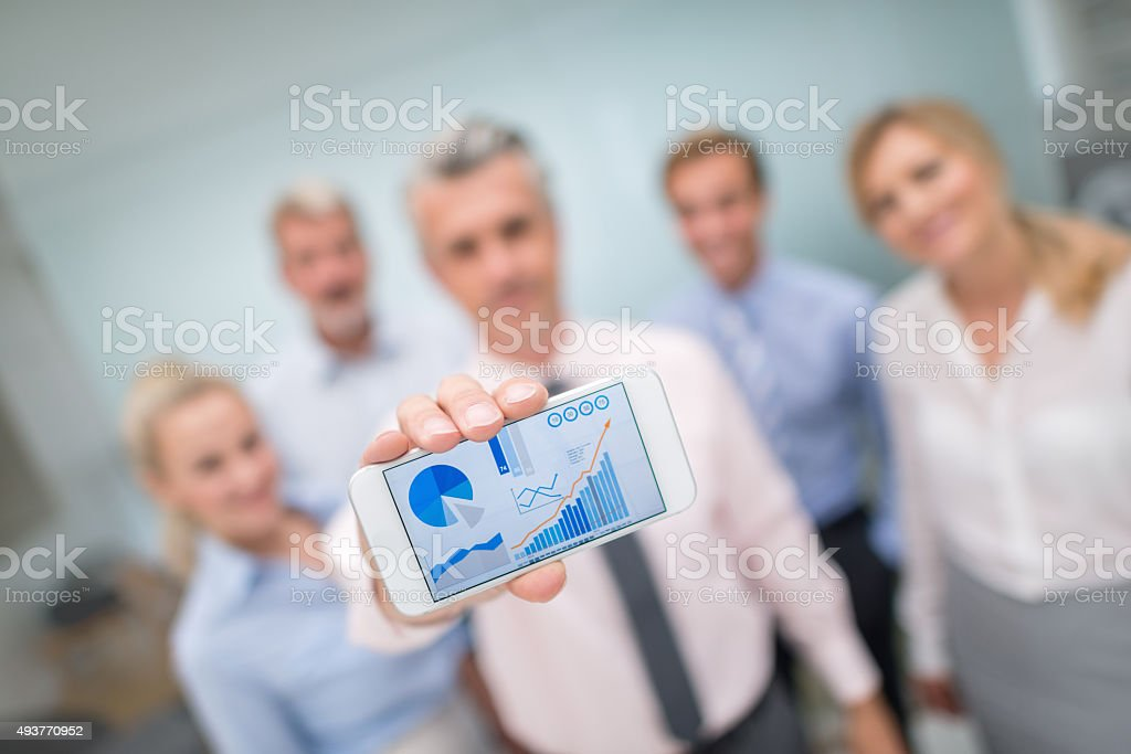 Business people showing online growth development stock photo