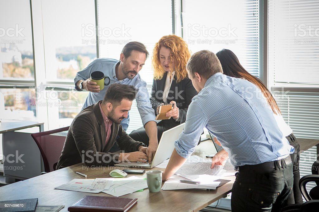 Business people showing team work in office stock photo