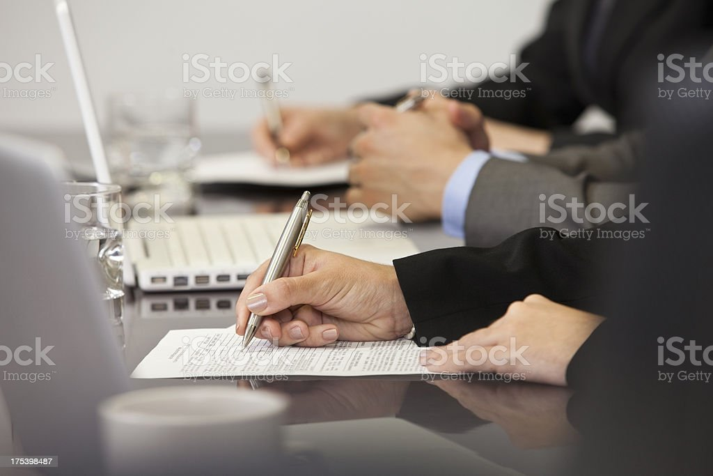 Business People Signing a Contract royalty-free stock photo
