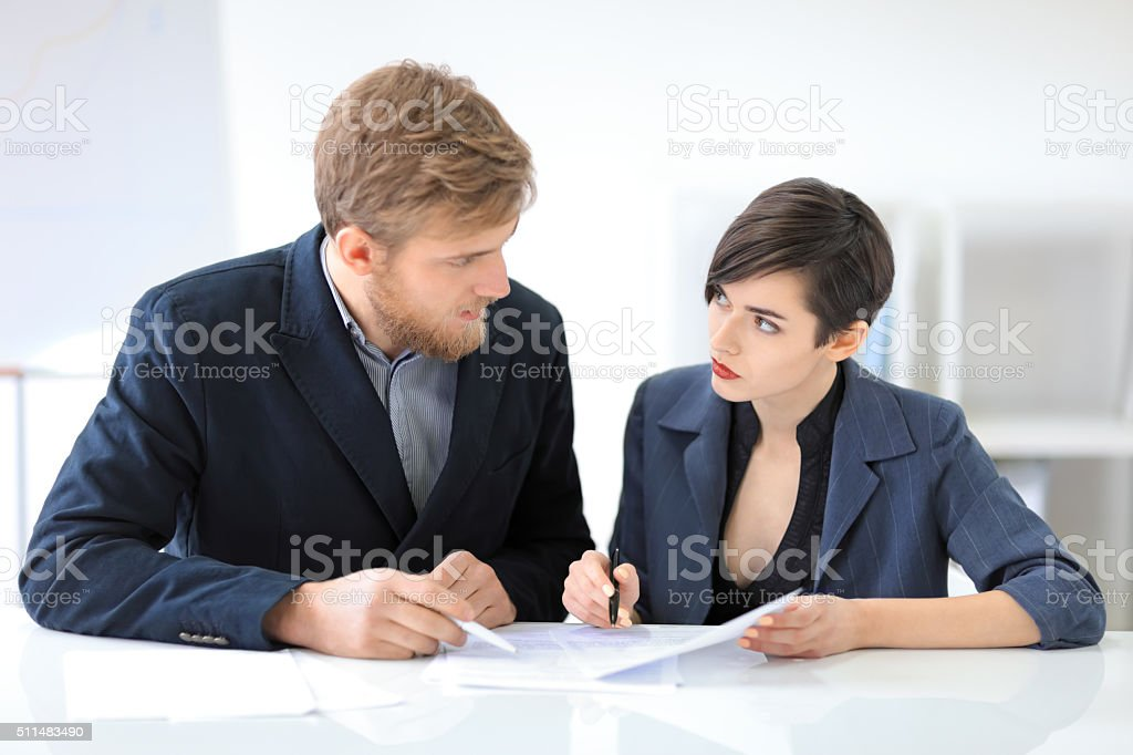 Business people signing a contract stock photo