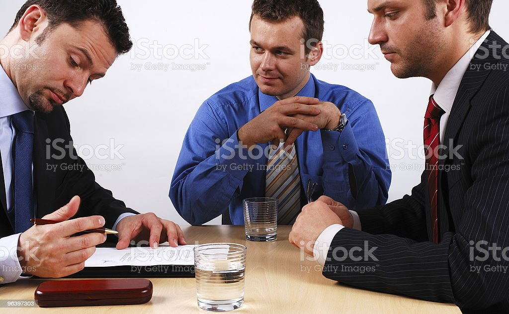 business people signing contract royalty-free stock photo