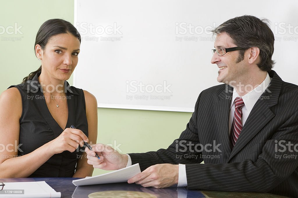 Business people signing contracts royalty-free stock photo