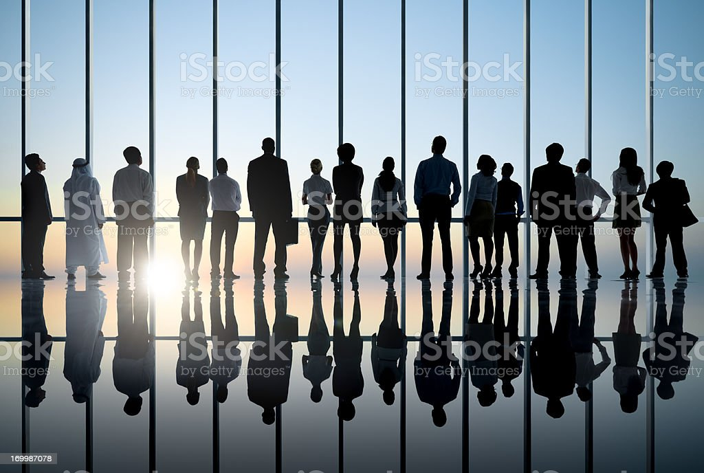 Business people silhouette staring at sunset. royalty-free stock photo