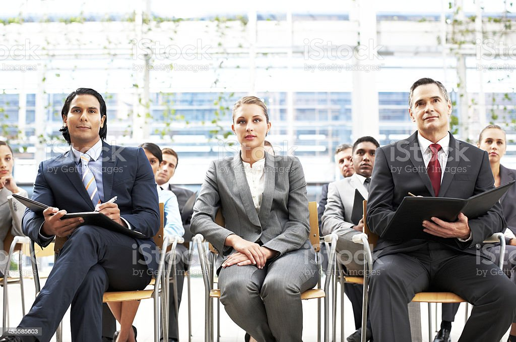 Business People Sitting at a Conference royalty-free stock photo