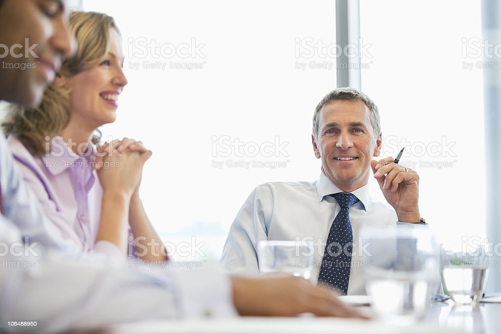 Business people sitting at conference table in board room royalty-free stock photo