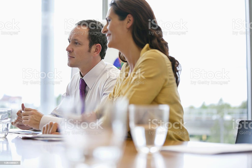 Business people sitting at conference table in office royalty-free stock photo