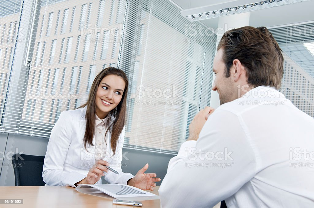 Business people sitting at the office stock photo