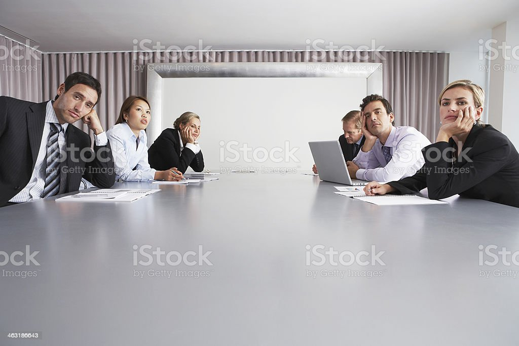 Business People Sitting In Conference Room stock photo