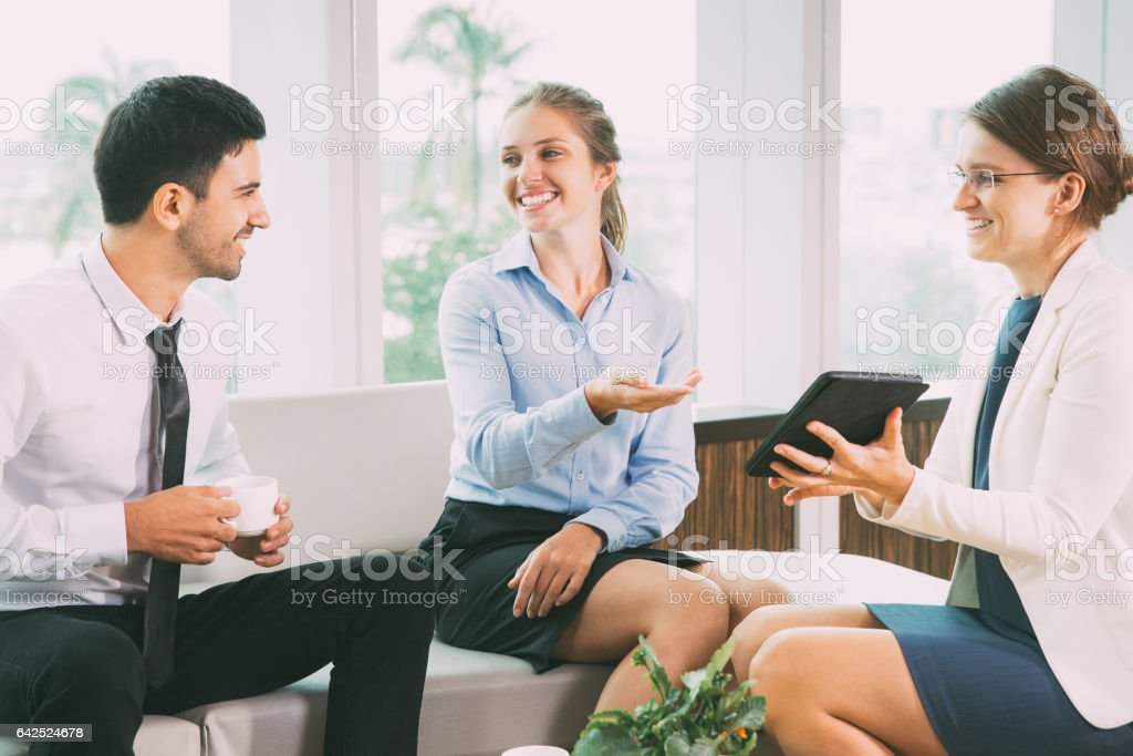 Business People Sitting in Modern Office stock photo