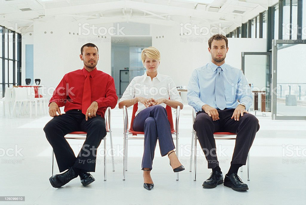 Business people sitting in office stock photo