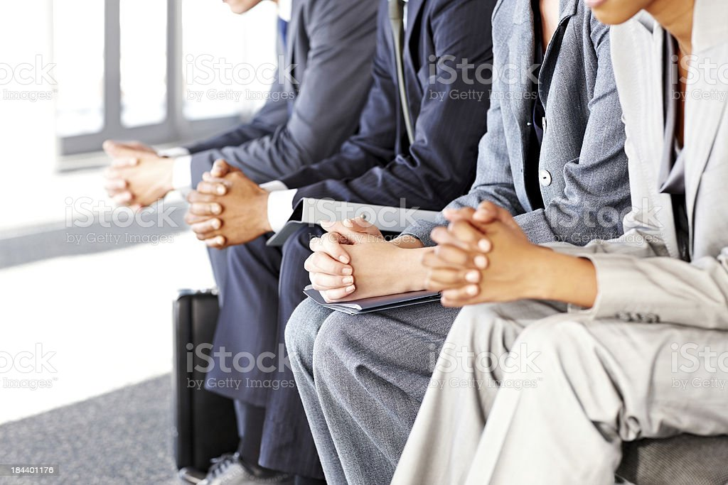 Business People Sitting Nervously royalty-free stock photo
