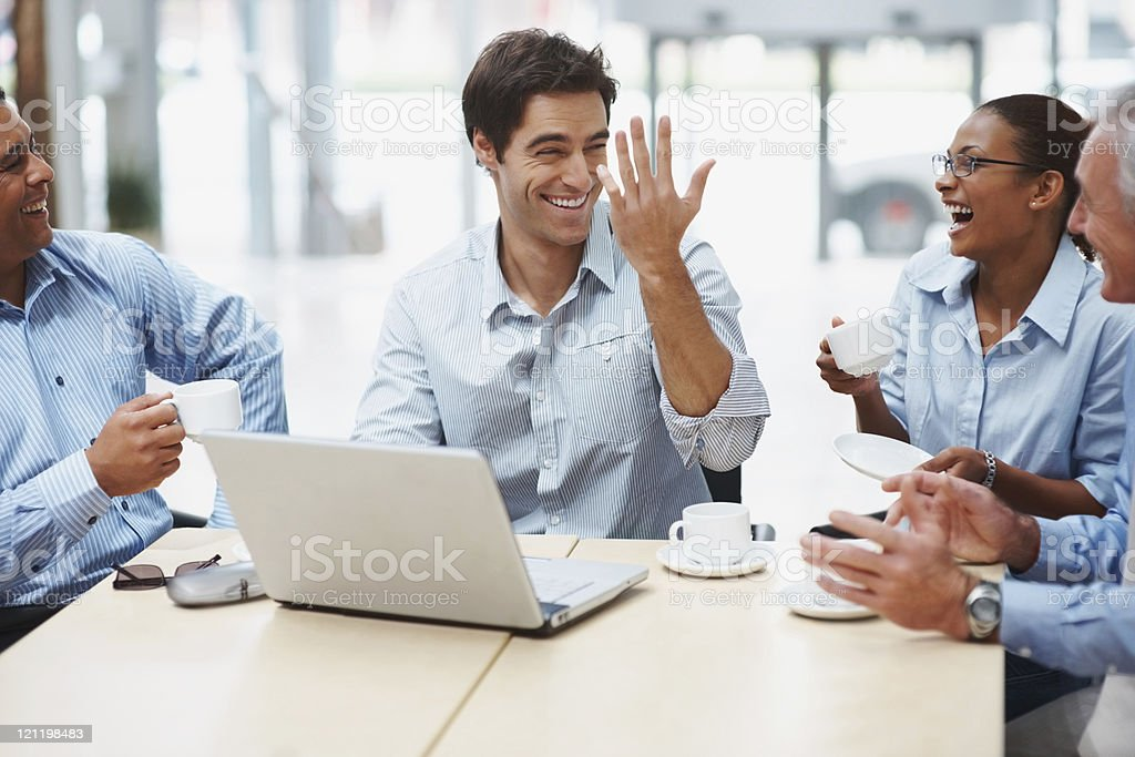 Business people sitting together and having a joyful time stock photo