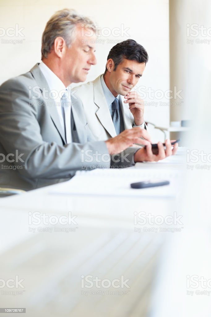 Business people sitting together calculating in an office royalty-free stock photo