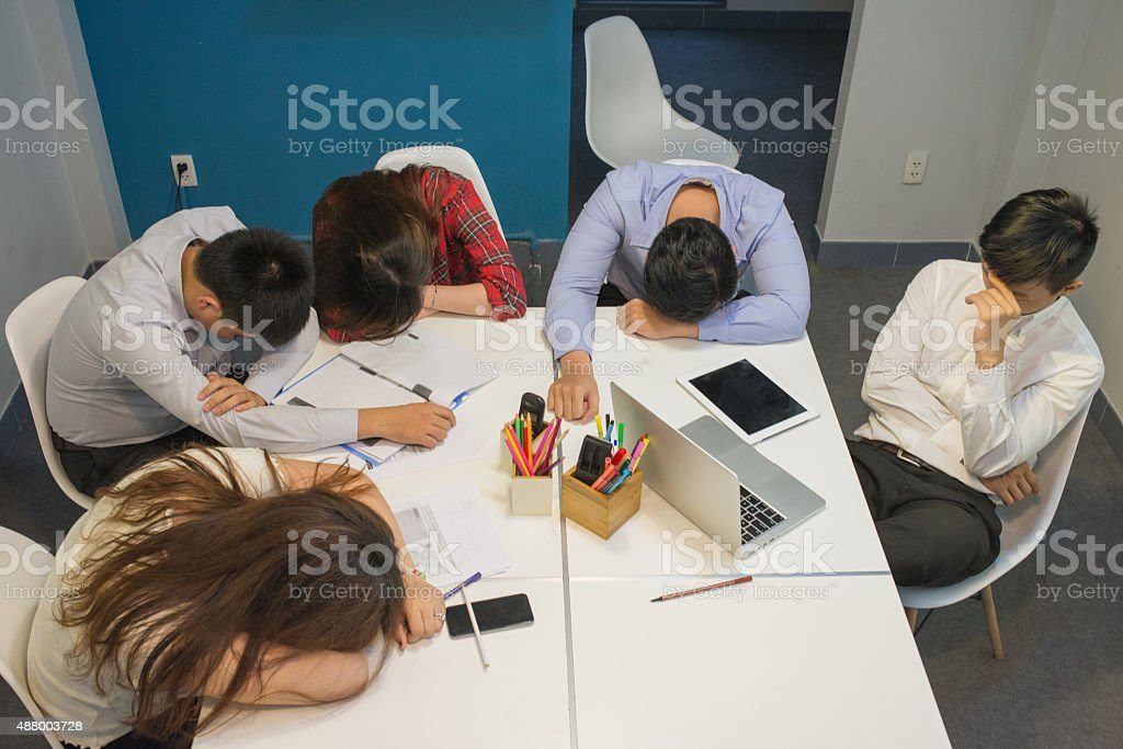Business people sleeping after a long, tired meeting day stock photo