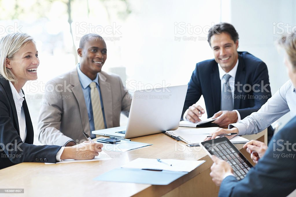 Business people smiling during a meeting royalty-free stock photo