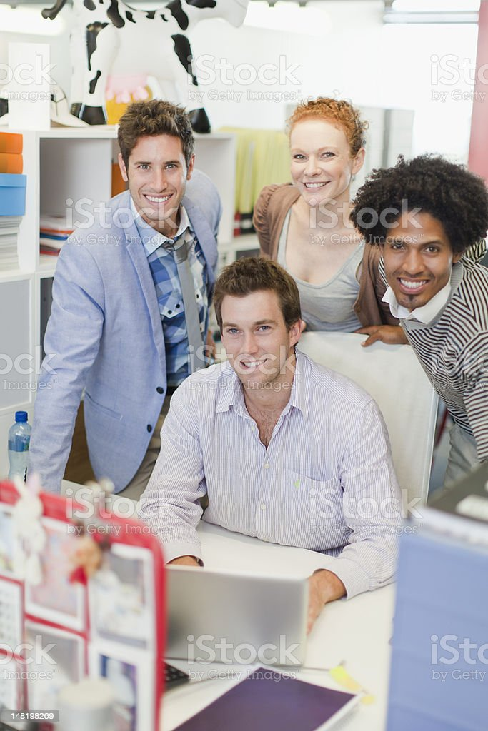 Business people smiling in office stock photo