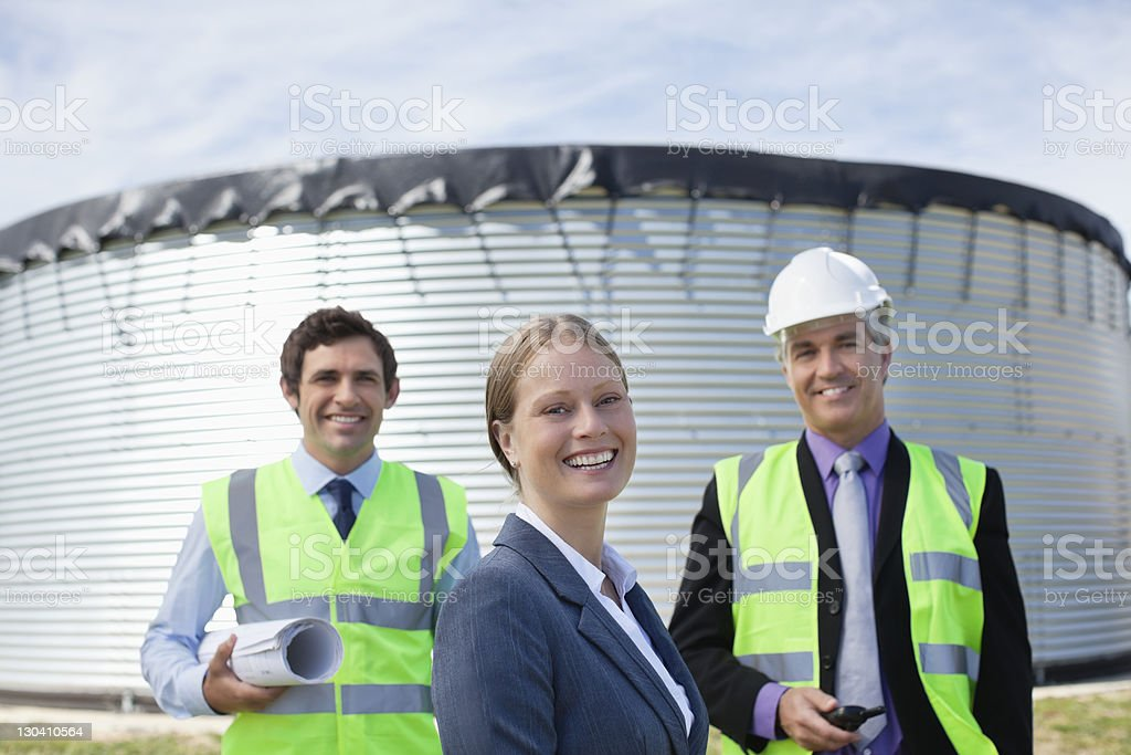 Business people smiling together outdoors royalty-free stock photo