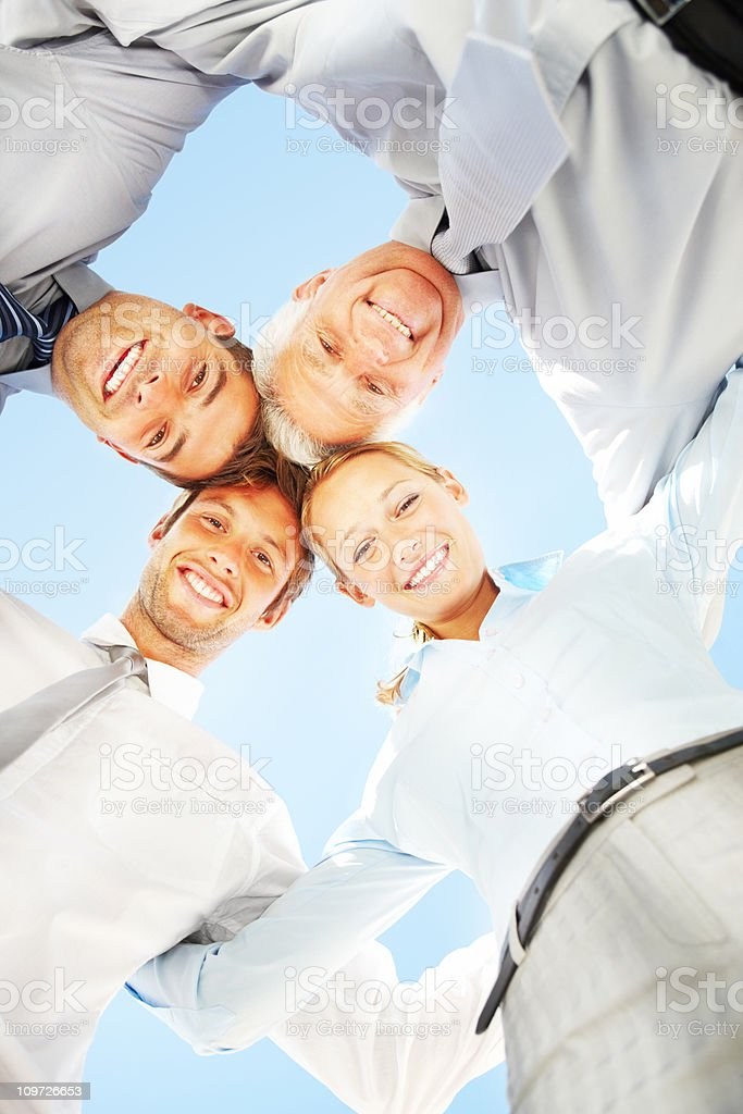 Business people smiling with heads together royalty-free stock photo