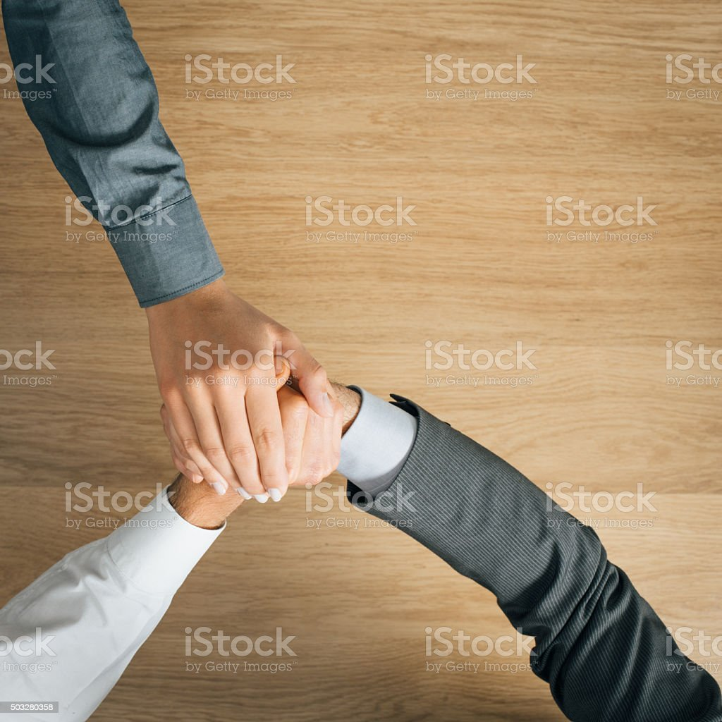 Business people stacking hands stock photo