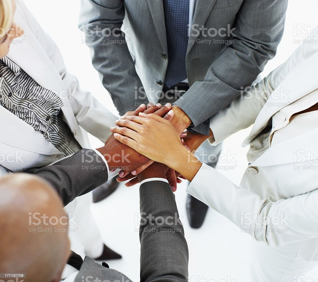 Business people stacking their hands royalty-free stock photo