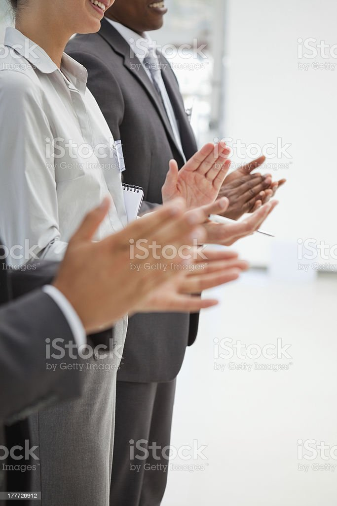 Business people standing and applauding royalty-free stock photo