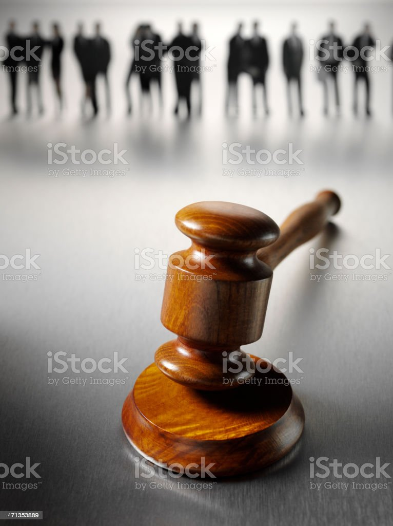Business People Standing Around a Gavel royalty-free stock photo
